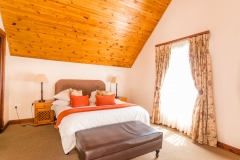 Sleep soundly in one of the Family Cottage rooms after a day of discovering the Estate